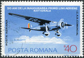 ROMANIA - CIRCA 1976: A stamp printed in the Romania, dedicated to the 50th anniversary of the Romanian airline, is depicted ICAR Comercial, circa 1976 — Stock Photo