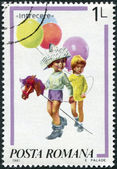 ROMANIA - CIRCA 1981: A stamp printed in the Romania, depicts a girl with balloons and a boy with a hobby horse (toy), painting by Norman Rockwell, circa 1981 — Stock Photo
