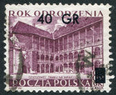 POLAND - CIRCA 1953: A stamp printed in the Poland, shows the inner courtyard of the palace Wawel, Krakow (overprint 1956), circa 1953 — Stock Photo