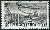POLAND - CIRCA 1952: A stamp printed in the Poland, shows the aircraft flying over the steel plant, circa 1952 — Stock Photo