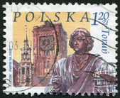 POLAND - CIRCA 2003: A stamp printed in the Poland, the city is depicted Thorn (Torun), town hall and a monument to Copernicus, circa 2003 — Stockfoto