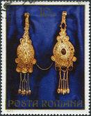 ROMANIA - CIRCA 1973: A stamp printed in the Romania, shows the gold jewelery from Pietroasa, Fibulae (brooch), circa 1973 — Stock Photo