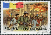 ROMANIA - CIRCA 1990: A stamp printed in the Romania, dedicated to the first anniversary of the fall of the dictatorship of Ceausescu, is shown to Republic Square, B — Stock Photo