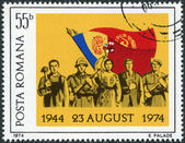 ROMANIA - CIRCA 1974: A stamp printed in the Romania, dedicated to 30th anniversary of Romania's liberation from Fascist rule, shows the Romanians and Flags, circa 1 — Stock Photo