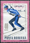 ROMANIA - CIRCA 1967: A stamp printed in the Romania, dedicated to the Winter Olympics in Grenoble, is shown biathlete, circa 1967 — Stock Photo