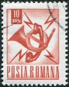 ROMANIA - CIRCA 1968: A stamp printed in the Romania, the emblem of the Post and Telecommunication, circa 1968 — Stock Photo