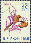 ROMANIA - CIRCA 1961: A stamp printed in the Romania, shows a musical instrument Bagpipes, circa 1961 — Stock Photo