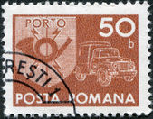 ROMANIA - CIRCA 1974: A stamp printed in the Romania, depicts the postal horn and postal car, circa 1974 — Stock Photo