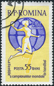 ROMANIA - CIRCA 1962: A stamp printed in the Romania, dedicated to the 2nd Women's Handball Championships, shows Handball Player on a globe, circa 1962 — Stock Photo