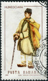 ROMANIA - CIRCA 1968: A stamp printed in the Romania, shows regional folk costumes, a man from Hunedoara, circa 1968 — Stock Photo