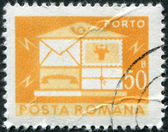 ROMANIA - CIRCA 1982: A stamp printed in the Romania, depicts the postal horn and postal car, circa 1982 — Stock Photo
