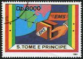 S. TOME E PRINCIPE - CIRCA 1991: A stamp printed in the S. Tome e Principe, shows part of the globe and cargo EMS, circa 1991 — Stock Photo