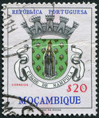 PORTUGAL - CIRCA 1961: A stamp printed in the Portugal, the emblem of the province of Nampula (overprint Mozambique), circa 1961 — Stock Photo