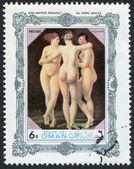Государство Оман - около неизвестно: марку, напечатанную в государства Оман, показывает окрашенные картины Жан Батист Реньо «три грации», около неизвестно — Стоковое фото