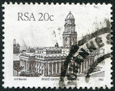 SOUTH AFRICA - CIRCA 1985: A stamp printed in South Africa (RSA), shows a post office in Durban, circa 1985 — ストック写真