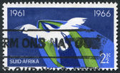 SOUTH AFRICA-CIRCA 1966: A stamp printed in the South Africa, dedicated to 5 th anniversary of the Republic, shows the flight of a bird, a symbol of freedom, circa 1 — Stock Photo