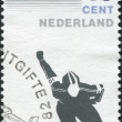 Stock Photo: NETHERLANDS - CIRC1982: stamp printed in Netherlands, is dedicated to 100th anniversary of Royal Dutch Skating Federation, shows skater, circ1982