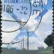 NETHERLANDS - CIRCA 2005: A stamp printed in the Netherlands, is shown Building Silhouettes, Wind Generator, Windmill and field, circa 2005 — Stock Photo