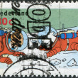 "NETHERLANDS - CIRCA 1999: A stamp printed in the Netherlands, shows an illustration of the book ""Explorers on the Moon"" by Georges Prosper Remi, Tintin, Snowy in spa — Stock Photo"