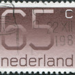 Stock Photo: NETHERLANDS - CIRC1986: stamp printed in Netherlands, shows value of postage stamp, circ1986