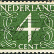Stock Photo: NETHERLANDS - CIRC1946: stamp printed in Netherlands, shows value of postage stamp, circ1946