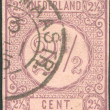 Stock Photo: NETHERLANDS - CIRC1876: stamp printed in Netherlands, shows value of postage stamp, circ1876