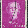 NETHERLANDS - CIRCA 1950: A stamp printed in the Netherlands, shows Juliana of the Netherlands, monogram J.M. and a crown, circa 1950 — Stock Photo