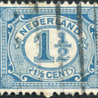 Stock Photo: NETHERLANDS - CIRC1899: stamp printed in Netherlands, shows value of postage stamp, circ1899