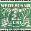 NETHERLANDS - CIRCA 1924: A stamp printed in the Netherlands, shows the value of a postage stamp and image of a flying pigeon (Gull), circa 1924 — Stock Photo