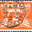 Stock Photo: NETHERLANDS - CIRC1924: stamp printed in Netherlands, shows value of postage stamp and image of flying pigeon (Gull), circ1924