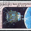 LAOS-CIRCA 1984: A stamp printed in the Laos, depicts the spacecraft Luna 3 — Stock Photo #12428003