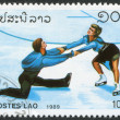 LAOS-CIRC1989: stamp printed in Laos, dedicated dedicated Winter Olympics Albertville, depicted Various figure skaters, circ1989 — Foto Stock #12428126