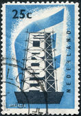 NETHERLANDS - CIRCA 1956: A stamp printed in the Netherlands, shows a character Rebuilding Europe, circa 1956 — Stock Photo