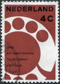 NETHERLANDS - CIRCA 1962: A stamp printed in the Netherlands, dedicated to the Completion of the automation of the Netherlands telephone network, shows a Telephone D — Stock Photo