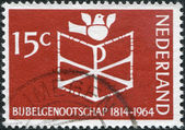 NETHERLANDS - CIRCA 1964: A stamp printed in the Netherlands, dedicated to the 150th anniversary of the founding of the Netherlands Bible Society, shows the Bible, C — Stock Photo