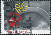 NETHERLANDS - CIRCA 1979: A stamp printed in the Netherlands, is dedicated to the International Year of the Child, shows a Hindu little girl, sleeping on the shoulde — ストック写真