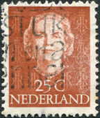 NETHERLANDS - CIRCA 1949: A stamp printed in the Netherlands, shows Juliana of the Netherlands, monogram J.M. and a crown, circa 1949 — Stock Photo