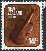 NEW ZEALAND - CIRCA 1976: A stamp printed in New Zealand, shows Kotiate, traditional type of handguns Maori, circa 1976 — Stock Photo