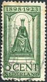 NETHERLANDS - CIRCA 1923: A stamp printed in the Netherlands, shows Wilhelmina of the Netherlands sits on the throne, circa 1923 — Stock Photo