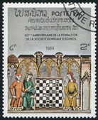 LAOS-CIRCA 1984: A stamp printed in the Laos, dedicated to the 60 anniversary of the World Chess Federation, Illustrations of various medieval and Renaissance chess — Stock Photo