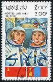 LAOS-CIRCA 1983: A stamp printed in the Laos, a symbol INTERCOSMOS - Space Cooperation Program of the USSR - Mongolia, circa 1983 — Foto de Stock