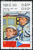 LAOS-CIRCA 1983: A stamp printed in the Laos, a symbol INTERCOSMOS - Space Cooperation Program of the USSR - Mongolia, circa 1983 — Stock Photo