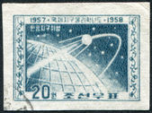 NORTH KOREA-CIRCA 1958: A stamp printed in the North Korea, dedicated to the International Geophysical Year, Sputnik-1 shows, circa 1958 — Stock fotografie