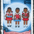 MADAGASCAR - CIRCA 1979: Postage stamps printed in Madagascar, is dedicated to International Children's Day, shows the children with books, toys, fruits, circa 1979 — Stock Photo