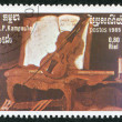 R.P.Kampuchea-CIRCA 1985: A stamp printed in the Kampuchea, depicts a violin lying on an armchair, circa 1985 — Stock Photo