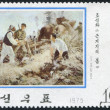 NORTH KOREA - CIRCA 1975: A stamp printed in North Korea, is dedicated to the history of the Revolution, shows the soldiers and farmers working in the field, circa 1 — Stock Photo