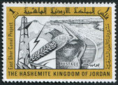 JORDAN-CIRCA 1963: A stamp printed in the Jordan, is devoted to East Ghor Canal Project, circa 1963 — Stock Photo