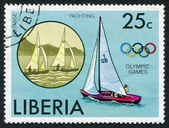 LIBERIA-CIRCA 1972: Postage stamps printed in Liberia, depicted the Olympic symbol and a yacht, circa 1972 — Stock Photo