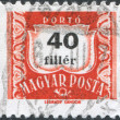 Stock Photo: HUNGARY - CIRC1958: stamp printed in Hungary, is depicted porto-mark, shield, face value 40 filler, circ1958