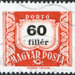 Stock Photo: HUNGARY - CIRC1958: stamp printed in Hungary, is depicted porto-mark, shield, face value 60 filler, circ1958